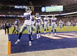 Dallas Cowboys wide receiver Dez Bryant (88) reacts after scoring a touchdown against the New York Giants in the third quarter of an NFL football game, Sunday, Nov. 23, 2014, in East Rutherford, N.J. (AP Photo/Frank Franklin II)
