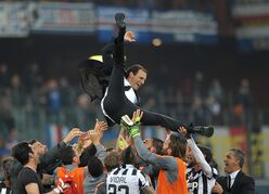 Juventus' coach Massimiliano Allegri is thrown in the air in celebration at the end of a Serie A soccer match between Sampdoria and Juventus, at the Luigi Ferraris stadium in Genoa, Italy, Saturday, May 2, 2015. Juventus clinched a fourth successive Serie A title with a 1-0 win at Sampdoria on Saturday but put its trophy celebrations on ice with a crucial Champions League match in just three days. (AP Photo/Carlo Baroncini)