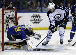 St. Louis Blues goalie Ryan Miller deflects a shot from Winnipeg Jets forward Anthony Peluso during the first period of an NHL game at the Scottrade Center in St. Louis Monday.