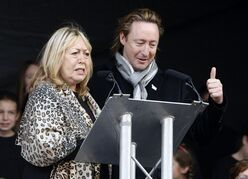 CAPTION CORRECTS THE DAY - File - In this Oct. 9, 2010 file photo, the son and former wife of singer John Lennon, Julian, right, and Cynthia Lennon, left, at the unveiling of a European peace monument dedicated to the memory of ex-Beatle John Lennon in Chavasse Park, Liverpool, England. Cynthia Lennon passed away on Wednesday, April 1, 2015, aged 75, at her home in Mallorca, Spain, following a short but brave battle with cancer. (AP Photo/Tim Hales, File)