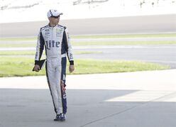 Driver Brad Keselowski walks to his garage before practice for the Brickyard 400 Sprint Cup series auto race at the Indianapolis Motor Speedway in Indianapolis, Saturday, July 26, 2014. (AP Photo/AJ Mast)