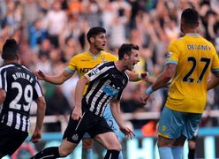 Newcastle United's Mike Williamson, center, celebrates his goal during their English Premier League soccer match against Crystal Palace at St James' Park, Newcastle, England, Saturday, Aug. 30, 2014. (AP Photo/Scott Heppell)