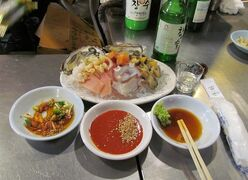 This February 2014 photo shows ice-cold sashimi in Seoul, one of Korea's many culinary surprises. The fish and other cuts of seafood are served with wasabi, soy and sesame sauce and usually topped off by one of the country's many rice wines. Seoul's hyper-efficient capital draws visitors with its exquisite restaurants, historic palaces and ultramodern infrastructure. (AP Photo/Amir Bibawy).