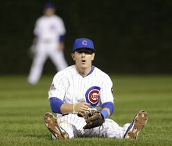 Chicago Cubs second baseman Logan Watkins reacts after making a throwing error during the ninth inning of a baseball game against the Los Angeles Dodgers in Chicago, Thursday, Sept. 18, 2014. (AP Photo/Nam Y. Huh)