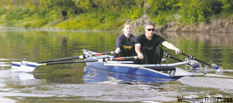 Blind rower Ross Eadie propels along the Red River with the aid of coach Juliana  Vipond.