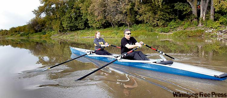 Eadie practises his rowing technique on the water with coach Vipond.
