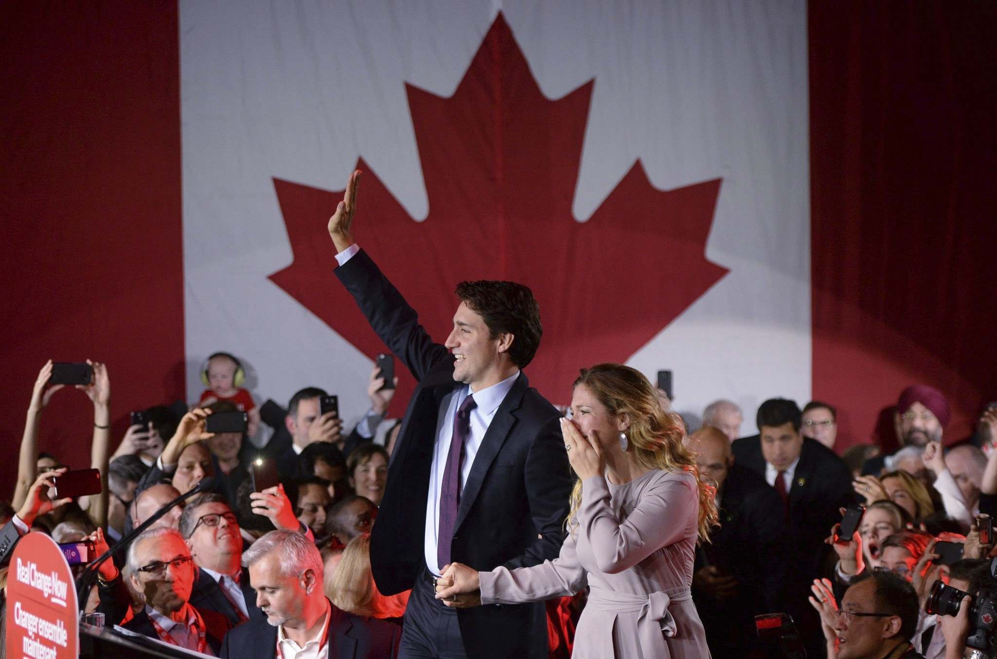Justin Trudeau, with wife Sophie Grégoire-Trudeau, celebrates his victory last October. He just marked his first 100 days in power.