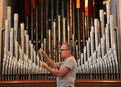 Steve Miller restores a pipe organ in St. Matthew's Cathedral Church. The organ comprises more than 2,200 individual lead alloy pipes.