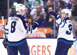Winnipeg defenceman Tobias Enstrom (right) celebrates his second-period goal with teammate Jacob Trouba.