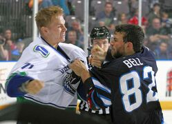 Winnipeg Jets defenceman Zach Bell gets into a tussle with a Vancouver player during a game at the Canucks Young Stars Classic tournament at the South Okanagan Events Centre in Penticton, B.C., Sunday.