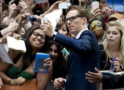 Actor Benedict Cumberbatch poses for photographs with fans for the new movie