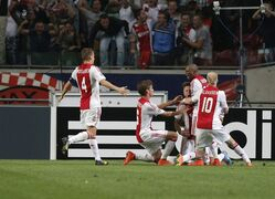 Ajax teammate celebrates Ajax's Lasse Schone's goal, third right, during the Group F Champions League match between Ajax and Paris Saint-Germain at ArenA stadium in Amsterdam, Netherlands, Wednesday, Sept. 17, 2014. (AP Photo/Peter Dejong)