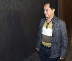 Diran Lin, father of victim Jun Lin, walks to the courtroom for the murder trial of Luka Rocco Magnotta in Montreal, Monday, Sept. 29, 2014. THE CANADIAN PRESS/Ryan Remiorz