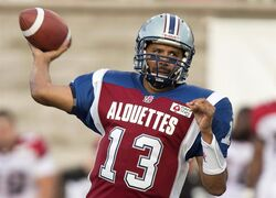 Montreal Alouettes quarterback Anthony Calvillo fires a pass downfield against the Calgary Stampeders during first quarter CFL football action in Montreal, July 12, 2013. The Alouettes will retire quarterback Calvillo's No. 13 on Oct. 13 when the club faces the Saskatchewan Roughriders.THE CANADIAN PRESS/ Paul Chiasson