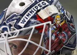 Woo-hoo! On the mask worn by Jets prospect Juho Olkinuora, Homer Simpson is off to wreak havoc in his Porsche.