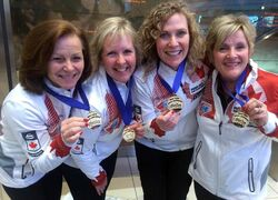 Talk about going out with a bang: Team Fowler arrives at Richardson International Airport Monday with gold medals in hand. From left: Allyson Stewart (lead), Cathy Gauthier (second), Maureen Bonar (third, vice-skip) and Lois Fowler (skip).