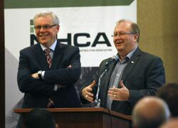 Premier Greg Selinger, left, and Chris Lorenc, president of the  Manitoba Heavy Construction Association, speak at the MHCA breakfast Tuesday morning.