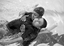 Agnes Davis, president of swim, swim, swim I SAY, helps Aiden Rodriguez, 7, swim on his back during a lesson in the Bronx borough of New York.