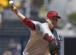 Arizona Diamondbacks starting pitcher Trevor Cahill throws against the San Diego Padres in the first inning of a baseball game Monday, Sept. 1, 2014, in San Diego. (AP Photo/Lenny Ignelzi)