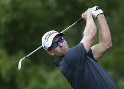 Adam Scott, of Austraila, hits from the tee on the second hole during the third round of play in the Tour Championship golf tournament Saturday, Sept. 13, 2014, in Atlanta. (AP Photo/John Bazemore)