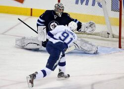Tampa Bay Lightning sniper Steven Stamkos misses the net as Winnipeg Jets goaltender Ondrej Pavelec sprawls to try to stop the puck during first-period NHL action in Winnipeg, Sunday.