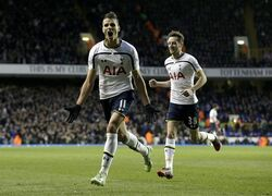 Tottenham Hotspur's Erik Lamela, left, celebrates scoring his side's second goal with Ryan Mason during the English Premier League soccer match between Tottenham Hotspur and Burnley at White Hart Lane stadium in London, Saturday, Dec. 20, 2014. (AP Photo/Matt Dunham)