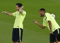 Barcelona's Lionel Messi, of Argentina, left, and Neymar of Brazil joke during a training session at Parc des Princes stadium in Paris, France, Monday, Sept. 29, 2014. Paris Saint Saint Germain will face Barcelona in a Champions League Group F soccer match Tuesday. (AP Photo/Michel Euler)