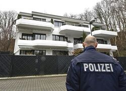 A police officer stands in front of a house where the co-pilot of the crashed Germanwings airliner jet is supposed to have lived in an apartment, in Duesseldorf,�Germany, Thursday March 26, 2015 during investigations of the crash of an aircraft in the French Alps on Tuesday killing 150 people. The co-pilot of the doomed Germanwings jet barricaded himself in the cockpit and