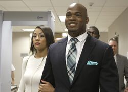 FILE - In this Nov. 4, 2014, file photo, Minnesota Vikings running back Adrian Peterson leaves the courthouse with his wife Ashley Brown Peterson in Conroe, Texas. A federal judge has cleared the way for Peterson to be reinstated. U.S. District Judge David Doty issued his order Thursday, Feb. 26, 2015, less than three weeks after hearing oral arguments. (AP Photo/Pat Sullivan, File)
