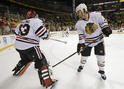 Chicago Blackhawks defenseman Brent Seabrook, right, slaps the pads of goalie Scott Darling (33) as they warm up before Game 2 of an NHL Western Conference hockey playoff series against the Nashville Predators, Friday, April 17, 2015, in Nashville, Tenn. (AP Photo/Mark Humphrey)