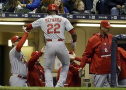 St. Louis Cardinals' Jason Heyward is congratulated after hitting a home run during the third inning of a baseball game against the Milwaukee Brewers, Friday, April 24, 2015, in Milwaukee. (AP Photo/Morry Gash)