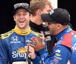 Drivers Marco Andretti, left, and Tony Kanaan enjoy a laugh a the ribbon cutting at the IndyCar Indy Grand Prix of Alabama auto race at Barber Motorsports Park, Saturday, April 25, 2015, in Birmingham, Ala. (Joe Songer/AL.com via AP) MAGS OUT; MANDATORY CREDIT