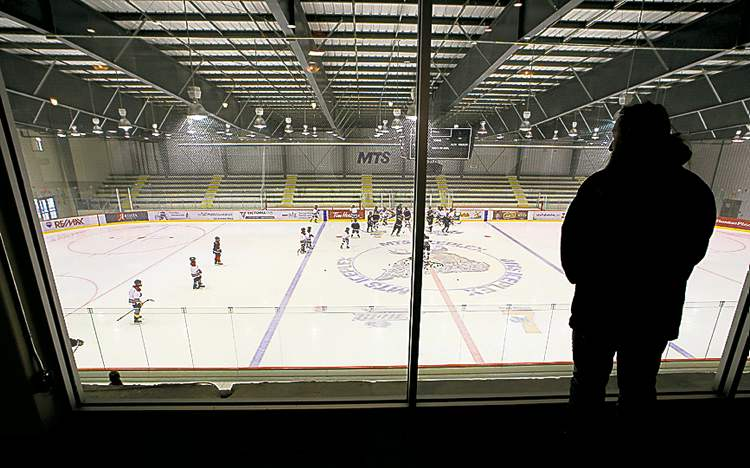 A minor hockey team practices on one of the sheets of ice.