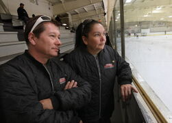 Richard and Holly Schwenzer watch their son, Kolden, practise with the Norquay Knights A1 at the West Kildonan Arena Friday.
