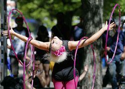 Lisa Lottie performs her hoop program at the Fringe Festival's free stage at The Cube, Friday. An estimated 95,000 people attended free shows in in Old Market Square during the 12-day event.