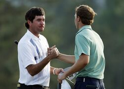 Bubba Watson, left, is congratulated by Jordan Spieth after winning the Masters golf tournament Sunday, April 13, 2014, in Augusta, Ga. (AP Photo/Matt Slocum)