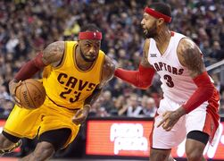 Cleveland Cavaliers forward LeBron James (23) drives the net past Toronto Raptors forward James Johnson (3) during first half NBA basketball action in Toronto on December 5, 2014. Cleveland's LeBron James and Stephen Curry of Golden State are the leading vote-getters in the first returns from NBA All-Star fan voting. THE CANADIAN PRESS/Nathan Denette