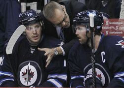 Jets head coach Paul Maurice talks to Bryan Little (left) and Andrew Ladd during second-period action at the MTS Centre.