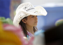 Glacier Wyryha, 6, of St. Anne, enjoys the stampede.
