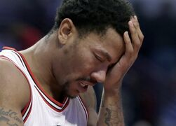 FILE- In this Nov. 10, 2014, file photo, Chicago Bulls guard Derrick Rose holds his head after being fouled during the second half of an NBA basketball game against the Detroit Pistons in Chicago. The news that Derrick Rose will have knee surgery again hit the Chicago Bulls and their fans hard and left them in a familiar spot _ trying to get by without their star point guard. The torn meniscus in his right knee was announced Tuesday night, Feb. 24, 2015, another tough twist for a franchise, a star, his sponsors and a fanbase that thought the Bulls were entering another golden era just a few years ago. (AP Photo/Charles Rex Arbogast, File)