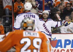 New York Rangers' Martin St. Louis, right, looks to celebrate his goal with Derek Stepan, middle, as Philadelphia Flyers goalie Ray Emery watches during the first period in Game 3 of an NHL hockey first-round playoff series, Tuesday, April 22, 2014, in Philadelphia. (AP Photo/Chris Szagola)