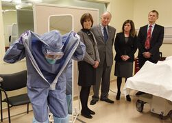 Judith Bosse (left to right), Assistant Deputy Minister at the Public Health Agency of Canada, Defence Minister Rob Nicholson, Health Minister Rona Ambrose and Dr. Gregory Taylor, Canada's Chief Public Health Officer, watch as nurse Adina Popalyar demonstrates how to remove protective clothing after treating a hypothetical Ebola patient at the Ottawa Hospital Research Institute, Thursday, November 27, 2014. THE CANADIAN PRESS/ Patrick Doyle