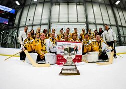 Jaime Simpson (goalie on left) and Cassandra Groen (goalie on right) celebrates winning the national championship with her U19AA Winnipeg Magic team.
