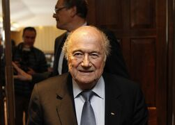 FIFA president Sepp Blatter leaves after the International Football Association Board (IFAB) meeting in Belfast, Northern Ireland, Saturday, Feb. 28, 2015. Sepp Blatter wants the 2022 World Cup final in Qatar to take place no later than Dec. 18, a date that would avoid a conflict with the powerful Premier League over the Christmas schedule in England. The dates of the 2022 tournament will be confirmed in March by the FIFA executive committee, which Blatter heads. (AP Photo/Peter Morrison)