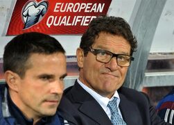 Russia's head coach Fabio Capello, right, reacts during the Euro 2016 Group G qualifying soccer match between Montenegro and Russia, at the City Stadium in Podgorica, Montenegro, Friday, March 27, 2015. (AP Photo/Risto Bozovic)