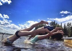 (Front to back) Risa Shatford, Nadia Minkevich, and Wayne Shatford head into the lake to cool off at Lake of the Woods. July 27, 2014