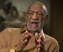 FILE - In this Nov. 6, 2014 file photo, entertainer Bill Cosby gestures during an interview about the upcoming exhibit,