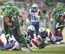 Saskatchewan Roughriders wide receiver Rob Bagg runs the ball past Montreal Alouettes corner back Billy Parker during the third quarter of CFL football action on Saturday, August 16, 2014 in Regina. THE CANADIAN PRESS/Liam Richards