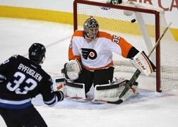Winnipeg Jets defenceman Dustin Byfuglien opens the scoring against Philadelphia Flyers goalie Steve Mason in the first period of Friday night's game at the MTS Centre.