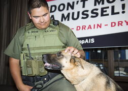 Natural resource officer Chad Moir with canine-unit member, Fauna, who will keep a nose out for zebra mussels.